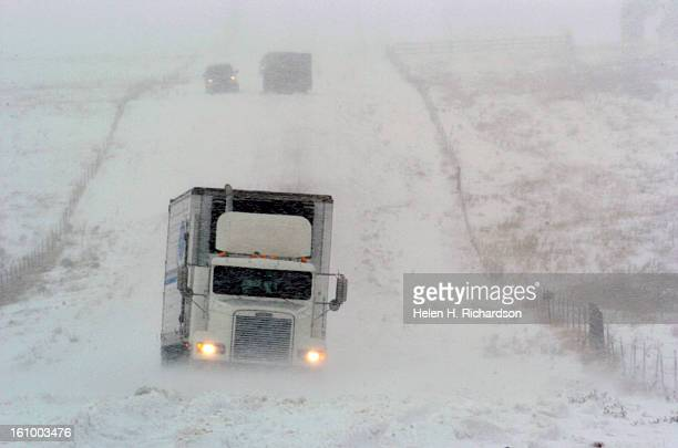 10_10_05_MONUMENT COLORADO Near Monument a trucker tries to power his rig out of heavy snow on County Line Road between Interstate 25 and Palmer Lake...