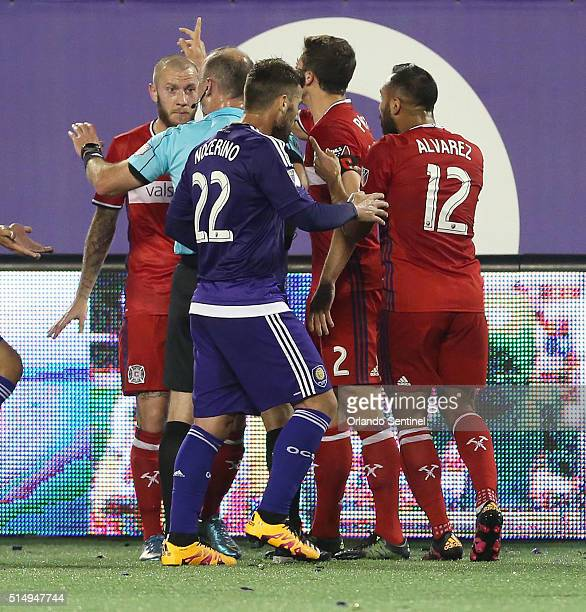 A near scuffle ensues as the Chicago Fire's Michael Harrington is issued a red card during play against Orlando City at the Orlando Citrus Bowl on...
