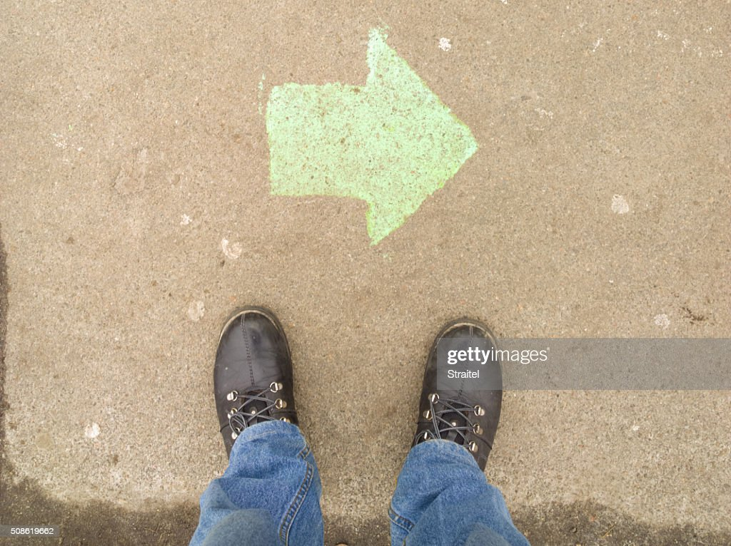 Near the foot of the arrow. : Stock Photo