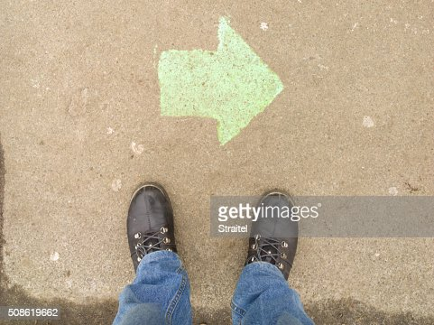 Near the foot of the arrow. : Stock Photo