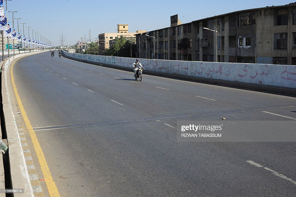 A near-empty overhead bridge is seen during a strike organised by the Muttahida Qaumi Movement (MQM) on followin the killing of lawmaker Manzar Imam and his guards in Karachi on January 18, 2013. Shops, businesses and schools shut Friday across Pakistan's financial capital Karachi, braced for further unrest after the killing of a politician and a night of sporadic shootings. AFP PHOTO/Rizwan TABASSUM