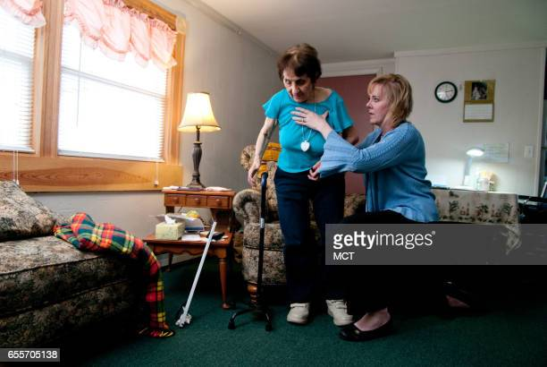 Nearly 1300 elderly and disabled adults like Elvira Tesarek shown May 2 2011 with physical therapist Tracie DelSesto at her Warren Rhode Island home...