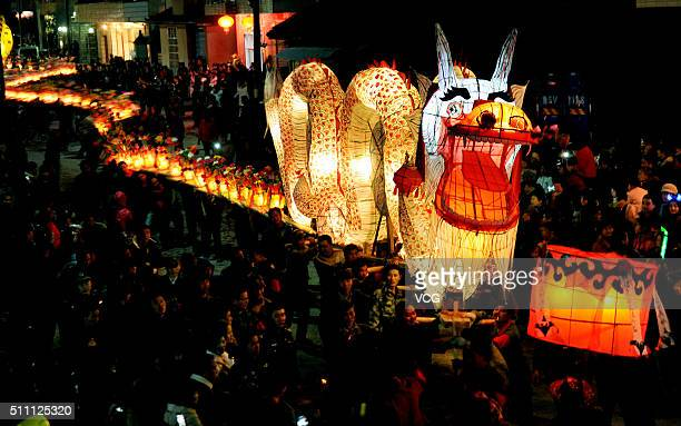 Nearly 200 farmers carrying a 150meter long dragon parade to celebrate the Spring Festival on February 17 2016 in Dexing Jiangxi Province of China...