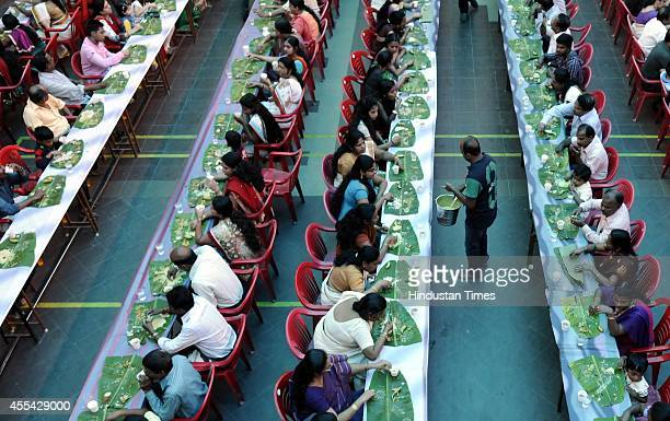 Nearly 2000 people of Malayali samaj participate in Onam feast organised by Lord Ayyappa Charitable Society on September 14 2014 in Indore India Onam...