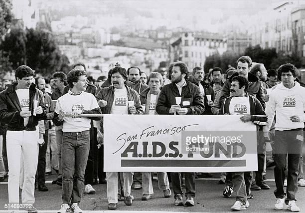 Nearly 2000 people participate in the annual candlelight parade honoring local hero Harvey Milk gay and lesbian pride and the social concerns of AIDS...
