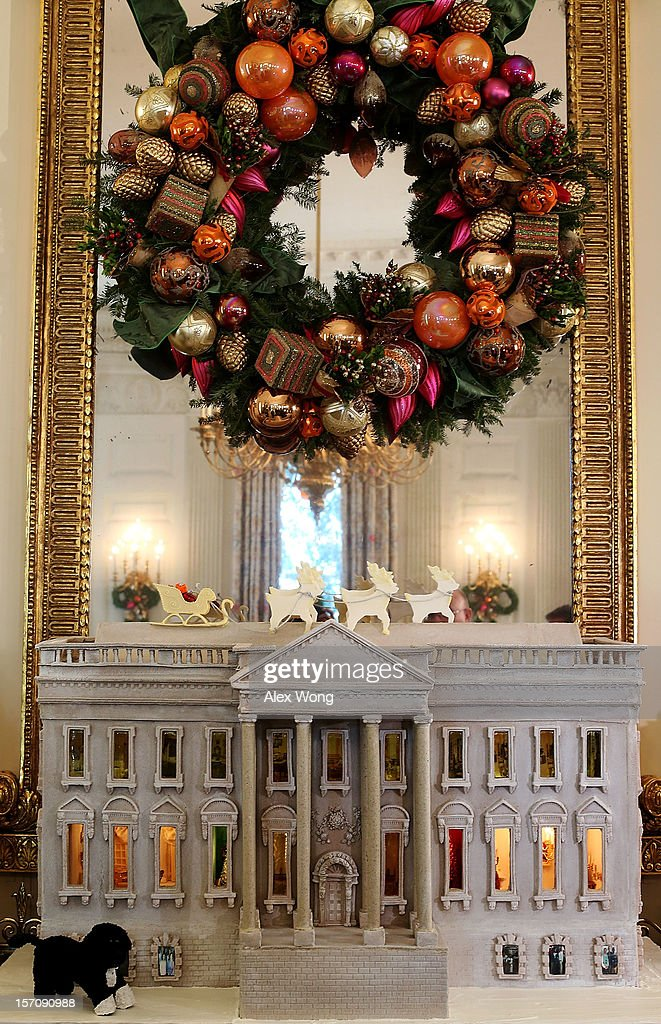 A nearly 300-pound White House gingerbread house is on display at the State Dining Room during a preview of the 2012 White House holiday decorations November 28, 2012 at the White House in Washington, DC. First lady Michelle Obama welcomed military families, including Gold Star and Blue Star parents, spouses and children, to the White House for the first viewing of the 2012 holiday decorations. The theme for the White House Christmas 2012 is 'Joy to All.'
