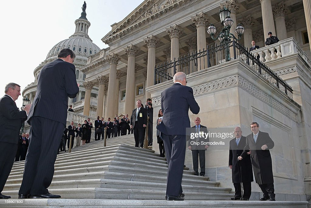 Nearly a year after suffering an major stroke, U.S. Sen. <a gi-track='captionPersonalityLinkClicked' href=/galleries/search?phrase=Mark+Kirk&family=editorial&specificpeople=2707485 ng-click='$event.stopPropagation()'>Mark Kirk</a> (R-IL) (R) is escorted by the Senate Sergeant at Arms Terrance Gainer and greeted by U.S. Vice President Joe Biden (4th R) as Kirk marks his return to the Senate by walking up the steps to the Senate door at the U.S. Capitol January 3, 2013 in Washington, DC. Kirk has spent the last 10 months learning to walk again after suffering a stroke on January 23, 2012.