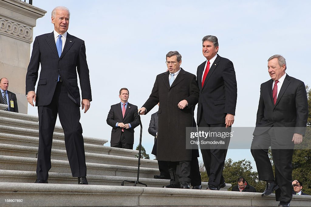 Nearly a year after suffering an major stroke US Sen Mark Kirk marks his return to the Senate by walking up the steps to the Senate door with US Vice...