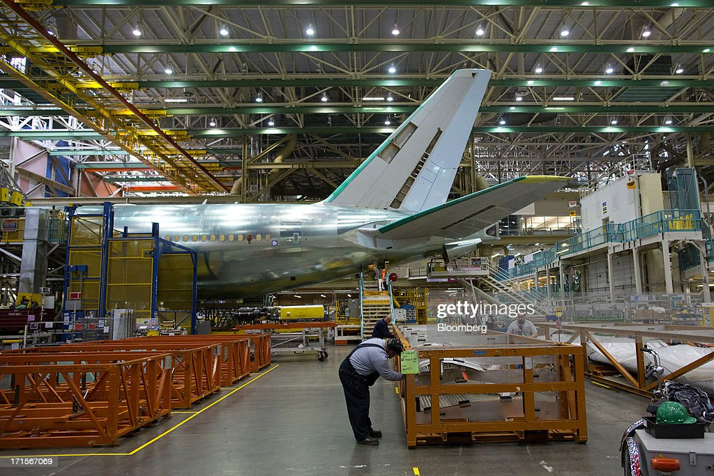 A nearly completed Boeing Co. 777 reaches the end of a moving production line at the company's facility in Everett, Washington, U.S., on Tuesday, June 25, 2013. Boeing Co. uses the Automated Spray Method (ASM), which consists of a robot with two guns that applies two paints at different thicknesses, to efficiently paint the wings of the popular 777 airplanes. Photographer: Mike Kane/Bloomberg via Getty Images