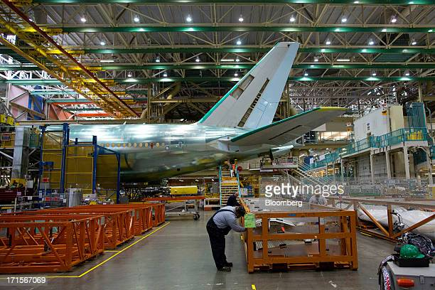 A nearly completed Boeing Co 777 reaches the end of a moving production line at the company's facility in Everett Washington US on Tuesday June 25...