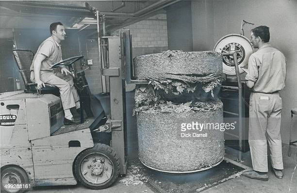 Nearly half a ton of leaf tobacco is weighed by Dave MacNeil and Harry Dykxhoorn before entering the production line at Benson and Hedges plant at...