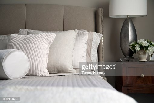 Neatly arranged pillows on a bed : Photo