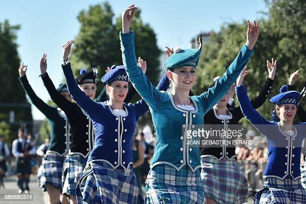 Neaw Zealand dancers of the Highland Dance Company perform on August 7 2016 in Lorient western France during the traditional street parade of the...