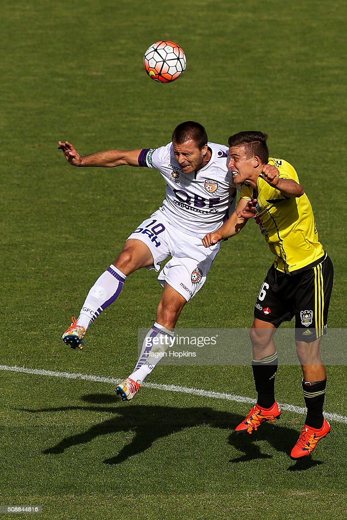 Nebojsa Marinkovic of the Glory and Louis Fenton of the Phoenix compete for a header during the round 18 A-League match between Wellington Phoenix and Perth Glory at Westpac Stadium on February 7, 2016 in Wellington, New Zealand.