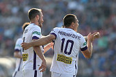 Nebojsa Marinkovic of the Glory celebrates a goal with team mate Gyorgy Sandor during the round 16 ALeague match between the Newcastle Jets and the...