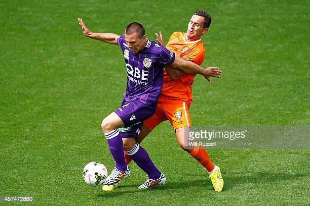 Nebojsa Marinkovic of the Glory controls the ball under pressure from Mensur Kurtisi of the Roar during the round two ALeague match between the Perth...