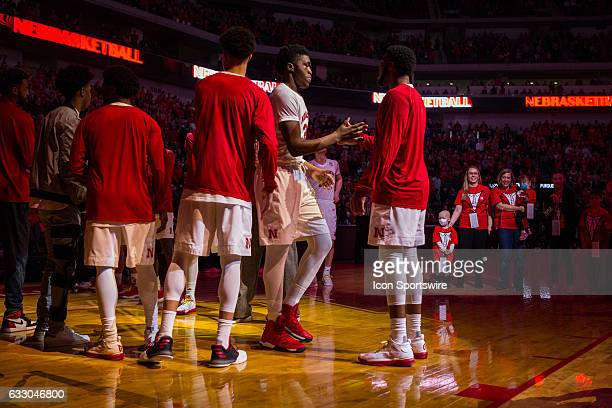 Nebraska Cornhuskers center Jordy Tshimanga is introduced before taking on Purdue Boilermakers while pediatric cancer patients take part for 'Suits...