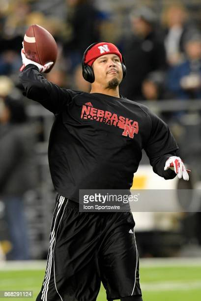 Nebraska Cornhuskers cornerbacks coach Donte Williams throws a pass during warm ups for the Big Ten conference game between the Purdue Boilermakers...