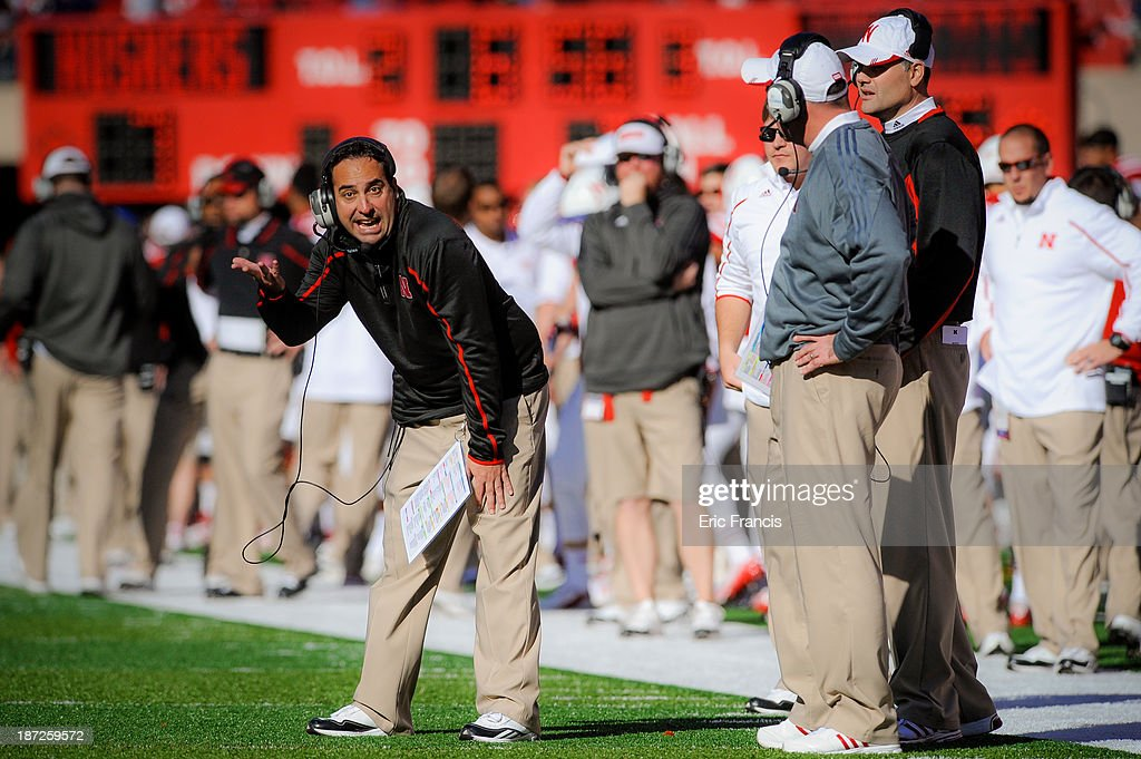 Nebraska Cornhuskers defensive coordinator John Papuchis reacts to head coach <a gi-track='captionPersonalityLinkClicked' href=/galleries/search?phrase=Bo+Pelini&family=editorial&specificpeople=4682479 ng-click='$event.stopPropagation()'>Bo Pelini</a> during their game against the Northwestern Wildcats at Memorial Stadium on November 2, 2013 in Lincoln, Nebraska.