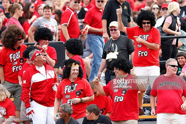 Nebraska Cornhuskers fans wearing afro wigs celebrate late in the game against the Purdue Boilermakers at RossAde Stadium on October 12 2013 in West...