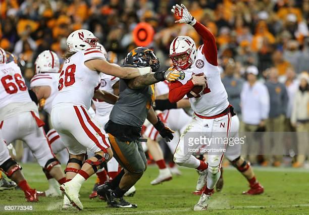 Nebraska Cornhuskers quarterback Ryker Fyfe avoids the sack by Tennessee Volunteers defensive end Derek Barnett during the second half of the...