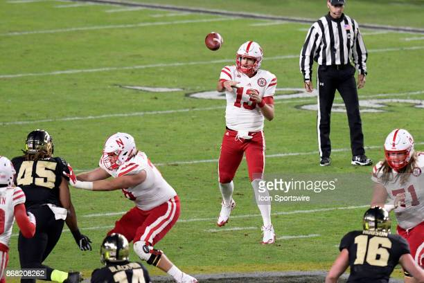 Nebraska Cornhuskers quarterback Tanner Lee passes the ball during the Big Ten conference game between the Purdue Boilermakers and the Nebraska...