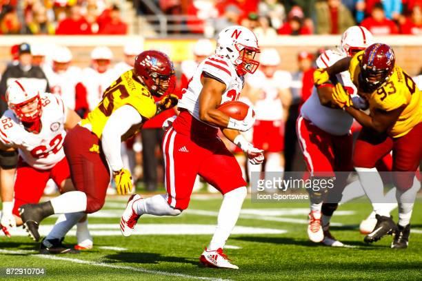 Nebraska Cornhuskers running back Devine Ozigbo rushes during the Big Ten Conference game between the Nebraska Cornhuskers and the Minnesota Golden...