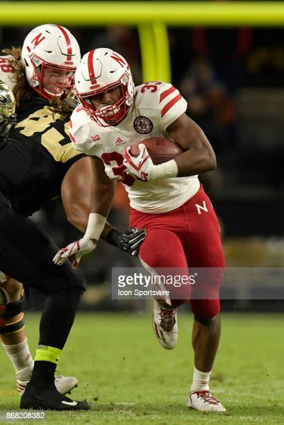 Nebraska Cornhuskers running back Jaylin Bradley finds a seam in the Purdue Boilermakers defense during the Big Ten conference game between the...