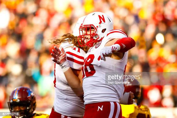 Nebraska Cornhuskers tight end Tyler Hoppes celebrates with offensive lineman Matt Farniok after scoring a touchdown in the 2nd quarter during the...