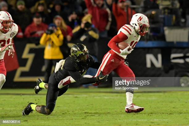 Nebraska Cornhuskers wide receiver JD Spielman is brought down by Purdue Boilermakers cornerback Jacob Abrams during the Big Ten conference game...