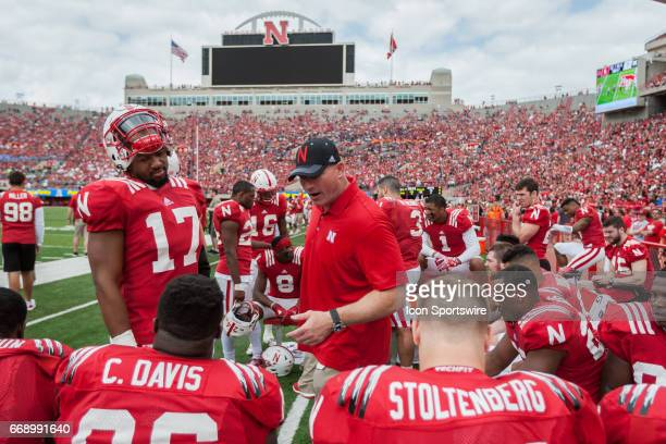 Nebraska defensive line coach John Parrella working with his players during the Spring Game at Memorial Stadium in Lincoln Nebraska Red 55 White 7