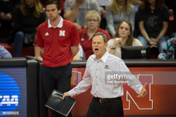 Nebraska head coach John Cook reacts to a call from the first referee during the third set in the match against Washington State Saturday December...