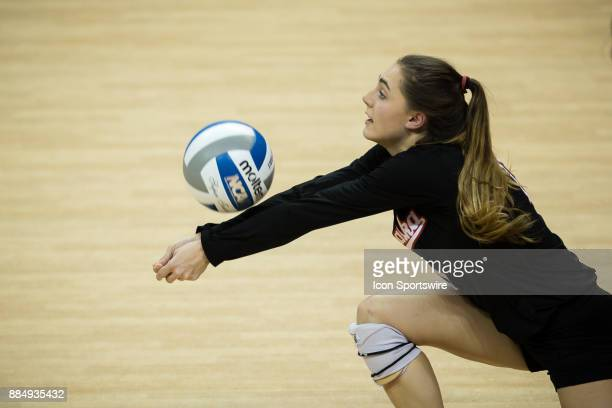 Nebraska libero Kenzie Maloney digs the ball against Washington State in the third set Saturday December 2nd at the Devaney Center in Lincoln...