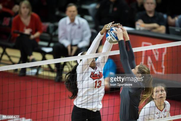 Nebraska middle blocker Briana Holman blocks a hit from Washington State setter Ashley Brown in the third set Saturday December 2nd at the Devaney...
