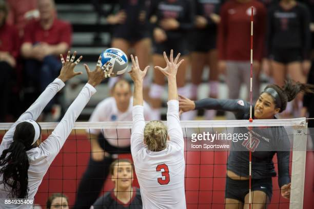 Nebraska middle blocker Briana Holman blocks a spike from Washington State outside hitter Taylor Mims for a point with Nebraska setter Kelly Hunter...