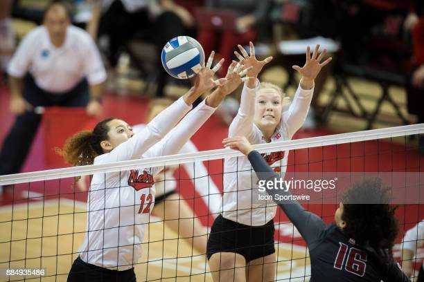 Nebraska outside hitter Jazz Sweet and Nebraska middle blocker Lauren Stivrins tries to block a spike from Washington State outside hitter Savanah...