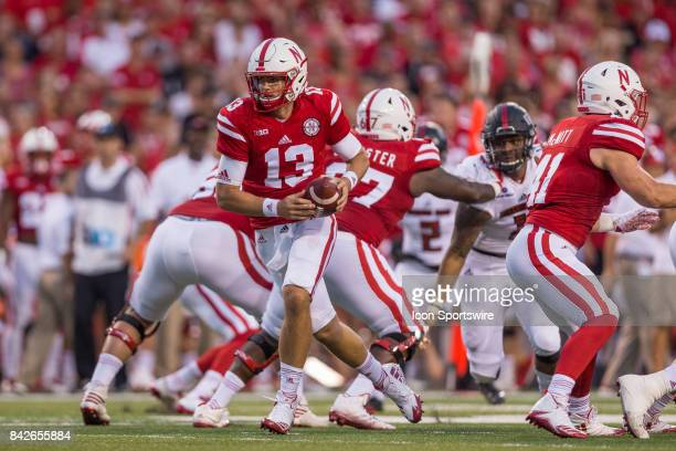 Nebraska quarterback Tanner Lee drops back to pass during the first half against the Arkansas State Red Wolves on September 02 2017 at Memorial...