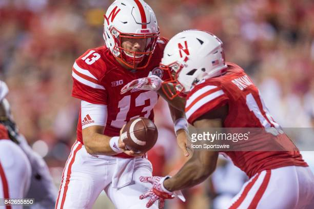 Nebraska quarterback Tanner Lee hands the ball off to Nebraska running back Tre Bryant during the first half against the Arkansas State Red Wolves on...