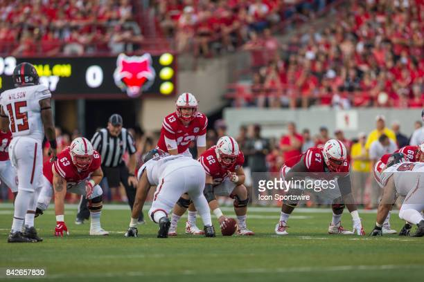 Nebraska quarterback Tanner Lee is ready to take the snap during the first half against the Arkansas State Red Wolves on September 02 2017 at...