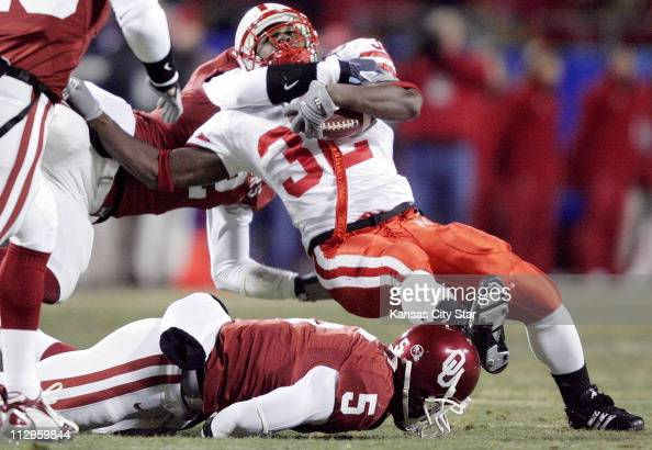 Nebraska running back Brandon Jackson is brought down by Oklahoma defensive back Brian Jackson in the first quarter during the Big 12 Championship...