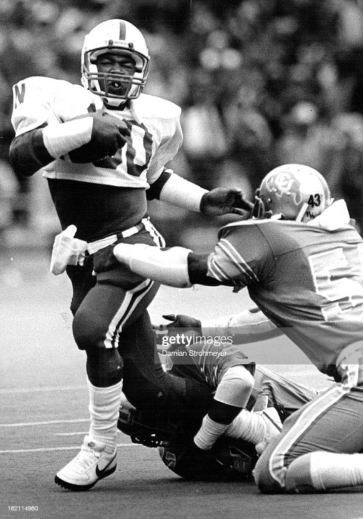 OCT 10 1982; Nebraska running back <a gi-track='captionPersonalityLinkClicked' href=/galleries/search?phrase=Mike+Rozier&family=editorial&specificpeople=622828 ng-click='$event.stopPropagation()'>Mike Rozier</a> twists out of ankie grasp and slips past the reach of Buffs' Sandy Armstrong.;