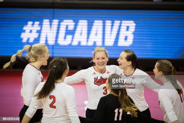 Nebraska setter Kelly Hunter and teammates celebrate a point against Washington State in the third set Saturday December 2nd at the Devaney Center in...