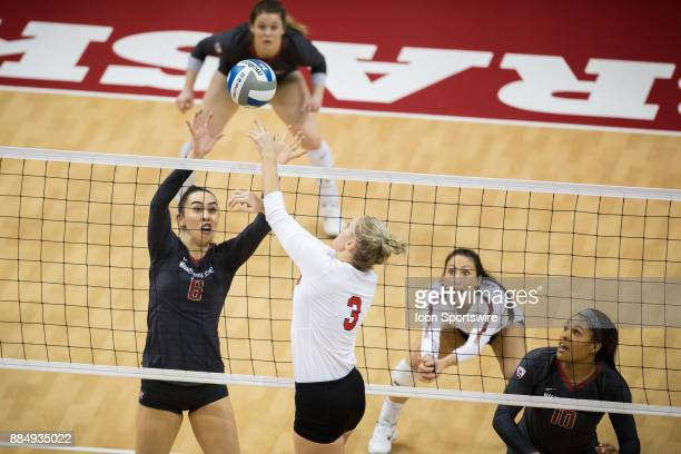 Nebraska setter Kelly Hunter bumps the ball over Washington State middle blocker Jocelyn Urias in the first set Saturday December 2nd at the Devaney...
