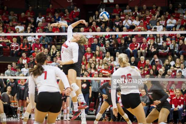 Nebraska setter Kelly Hunter taps the ball behind her against Washington State in the third set Saturday December 2nd at the Devaney Center in...