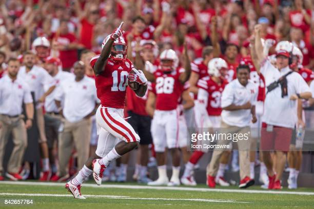 Nebraska wide receiver JD Spielman runs for at touchdown on a kick return during the first half against the Arkansas State Red Wolves on September 02...