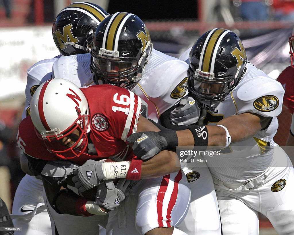 Nebraska wide receiver Maurice Purify is smothered by Missouri defenders after catching a pass in the first half at Memorial Stadium in Lincoln, Nebraska, November 4, 2006. The Huskers defeated the Tigers 34-20.