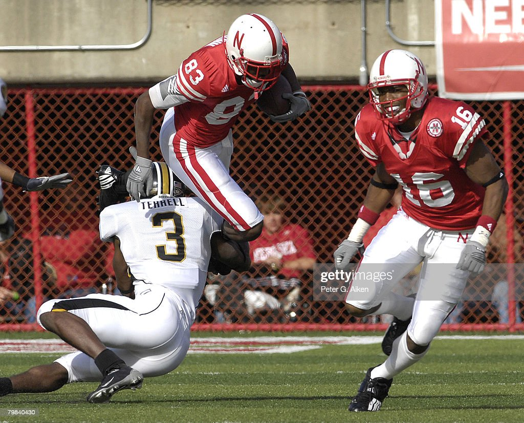 Nebraska wide receiver Terrence Nunn tries to leap over Missouri defensive back Darnell Terrell as Husker wide receiver Maurice Purify looks on in the first half at Memorial Stadium in Lincoln, Nebraska, November 4, 2006. The Huskers defeated the Tigers 34-20.