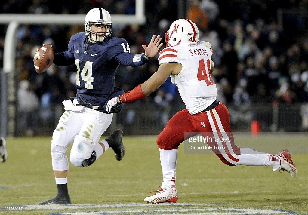 Nebraska's David Santos runs Penn State quarterback Christian Hackenberg (14) out of bounds at Beaver Stadium in University Park, Pa., on Saturday, Nov. 23, 2013. Nebraska won, 23-20.