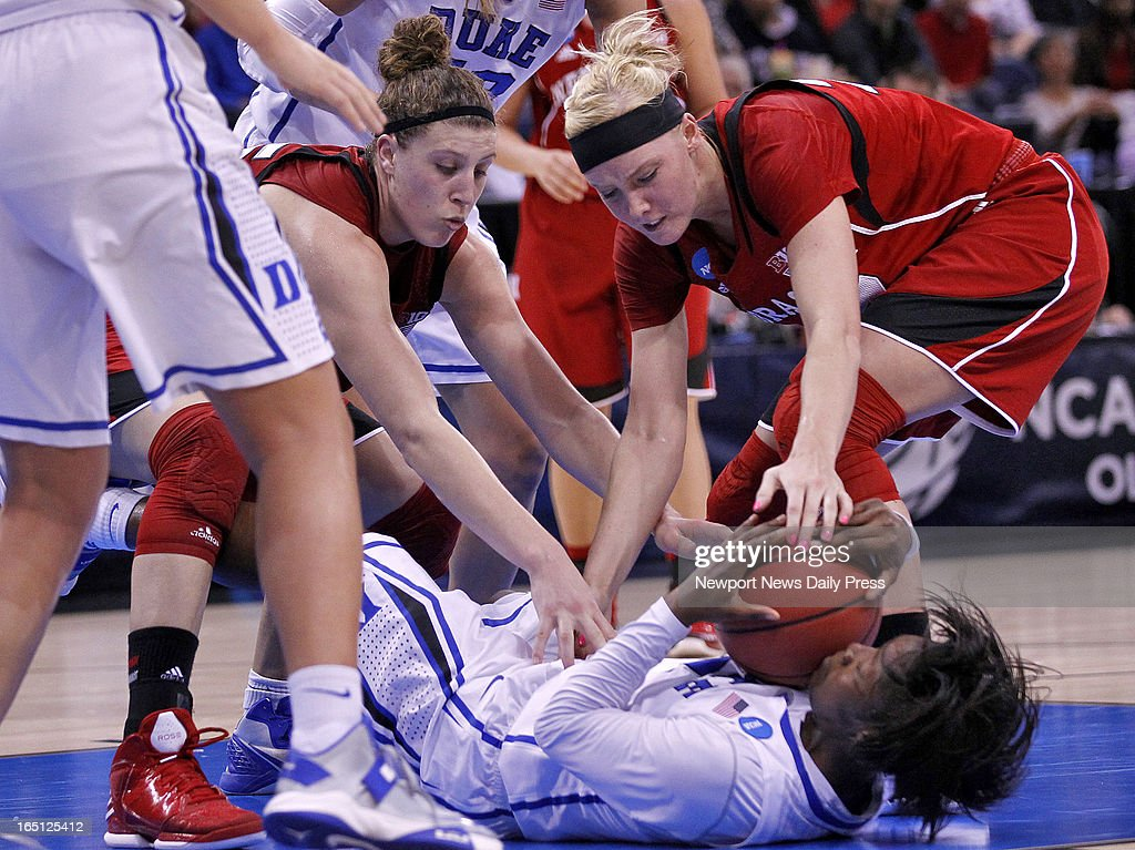 Nebraska's Jordan Hooper, left, and Emily Cady, right, wrestle for a loose ball with Duke's' Alexis Jones during Sunday's NCAA women's basketball regional semifinal on March 31, 2013, at the Ted Constant Center in Norfolk, Virginia. Duke won, 53-45.