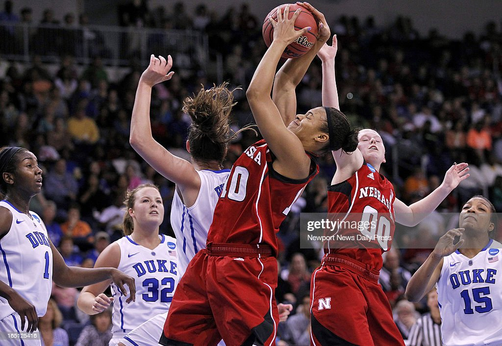 Nebraska's Meghin Williams, center, battles for a rebound with Duke's Haley Peters during Sunday's NCAA women's basketball regional semifinal on March 31, 2013, at the Ted Constant Center in Norfolk, Virginia. Duke won, 53-45.